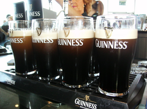 Pints of perfectly poured Guinness at St. James's Gate, Dublin